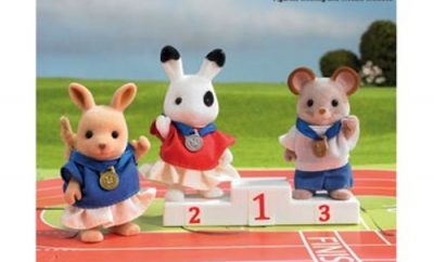 Sylvanian Families with medals on a podium.