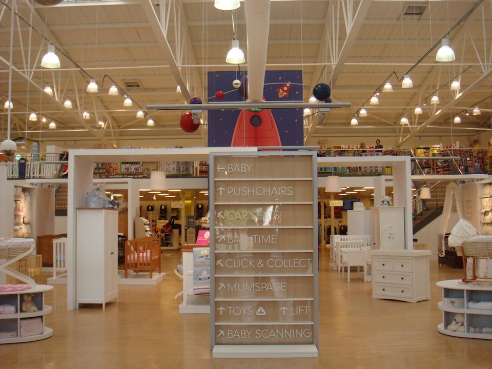 Signposts direct customers to the various departments within the newly designed Mothercare store in Edmonton.