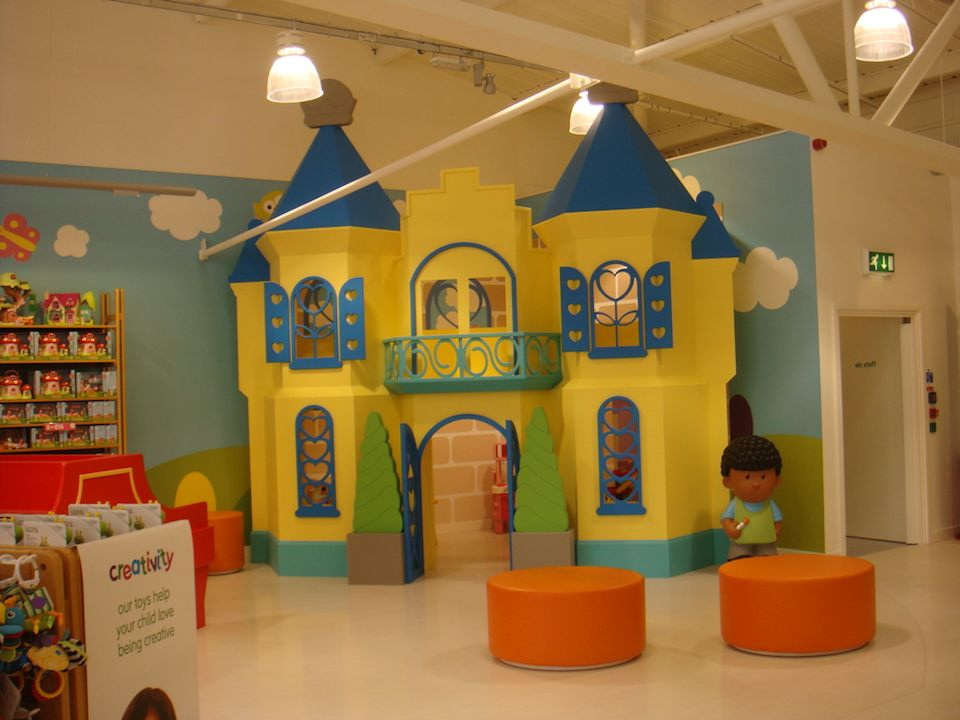 A big yellow palace (or castle) in the Early Learning Centre department within Mothercare Edmonton,