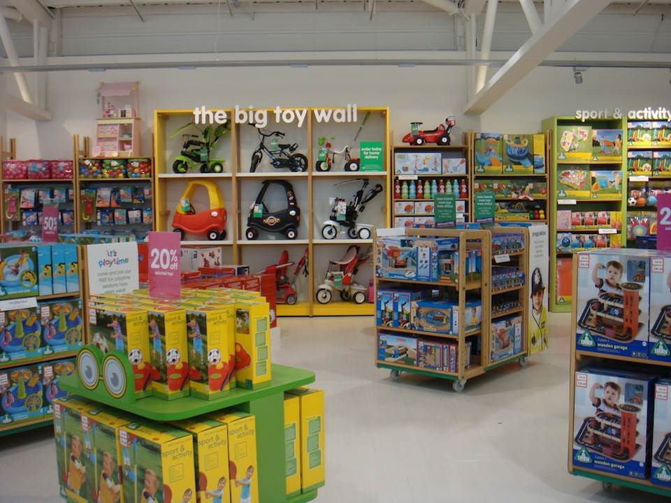 ELC : The Big Toy Wall, with Little Tikes Cozy Coupe and Mookie Smart Trike.